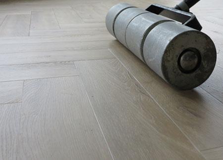 Wals over plak PVC dryback vloer